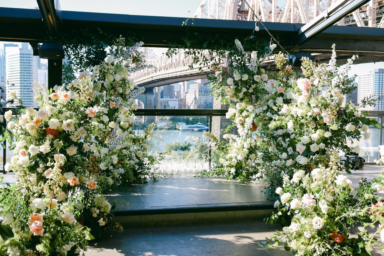 Intimate ceremony site with two crescents of greenery leading to views of the Queensboro Bridge   PartySlate