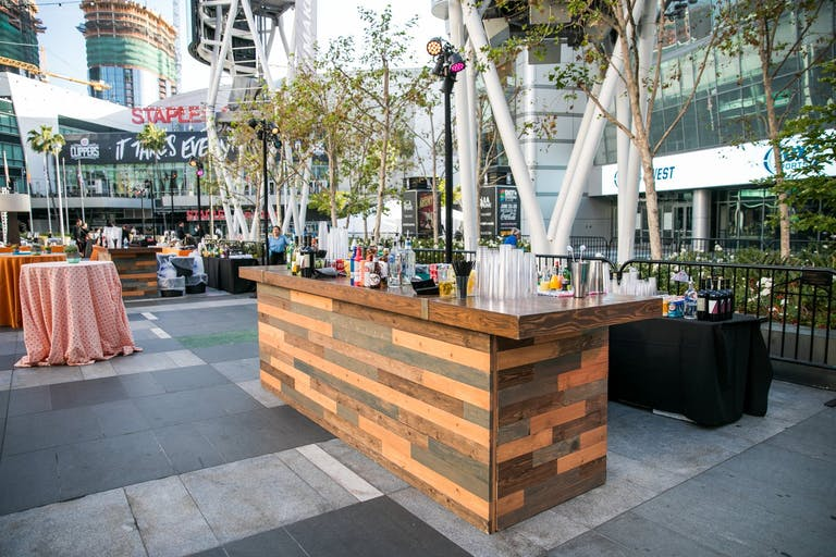 Outdoor corporate picnic with wooden bar set up at Microsoft Square at L.A. LIVE in Los Angeles, CA | PartySlate