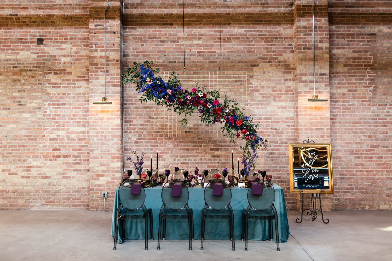 Minimalist wedding at WildmanBT with floating floral installation over tablescape in moody colors   PartySlate