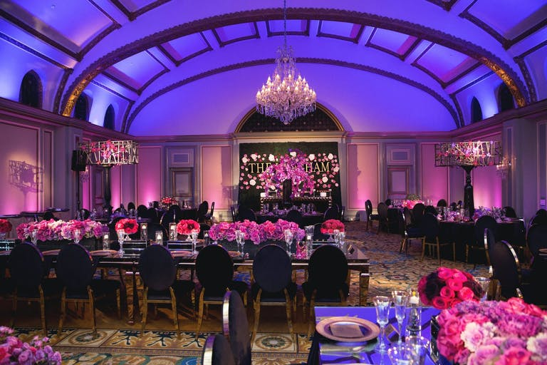 Corporate event at Viennese Ballroom at The Langham Huntington Hotel with purple uplighting and bright pink floral décor | PartySlate