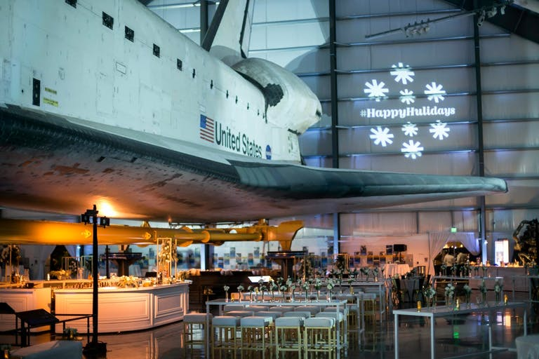 Company holiday party at Samuel Oschin Space Shuttle Endeavour Pavilion at California Science Center | PartySlate at