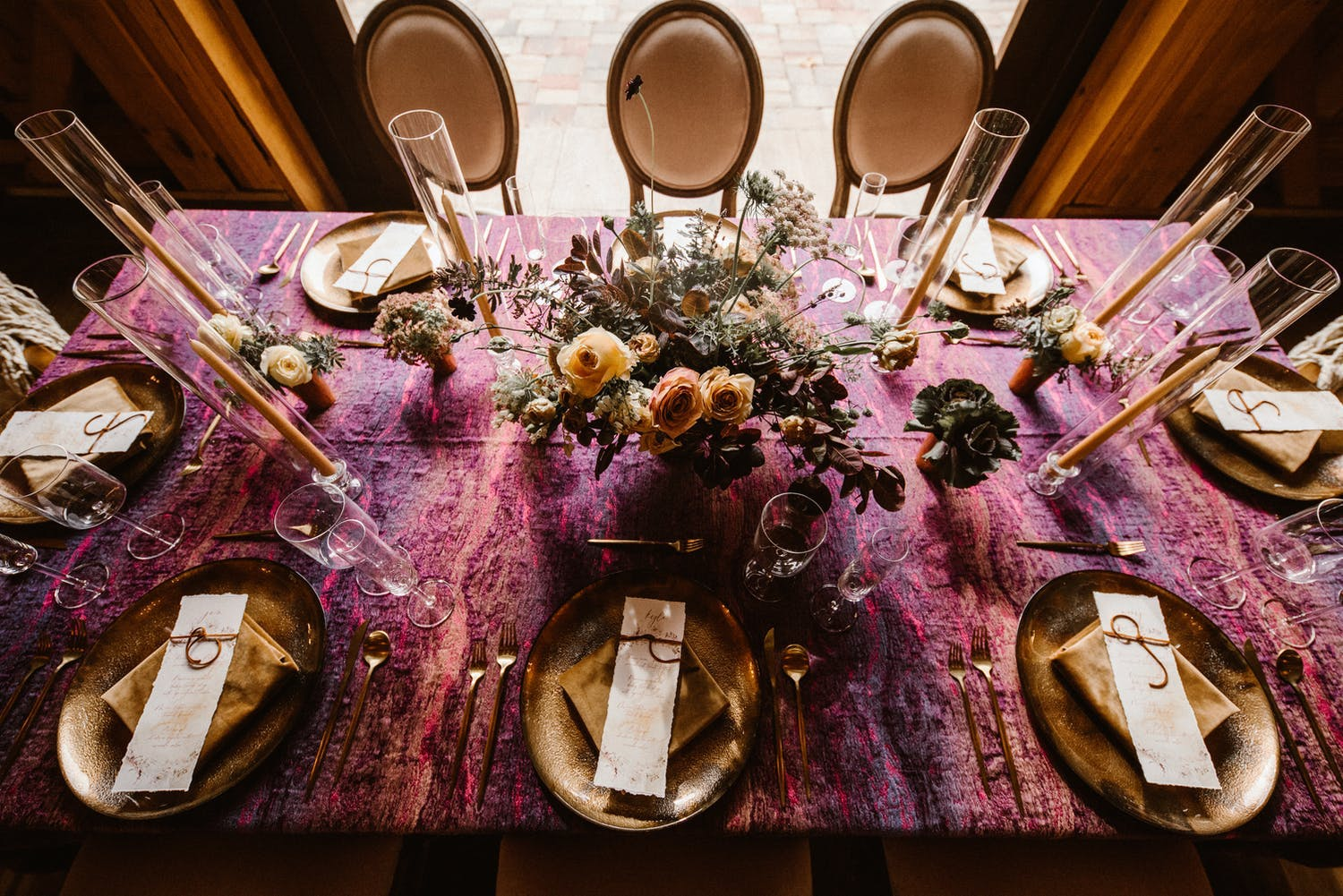 Intimate autumn tablescape with marbled mauve and plum linen along with copper accents   PartySlate